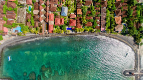Top view of the blue water coast line in Candidasa Beach. Bali, Indonesia stock images