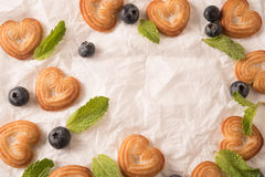 Top view of  blueberries,mint leaf and heart shaped biscuit  with space for text Royalty Free Stock Photos
