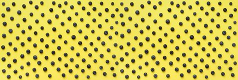 Top view of blueberries pattern on yellow background. Summer food concept Royalty Free Stock Photography