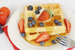 Top view blueberry strawberry syrup waffles Royalty Free Stock Images
