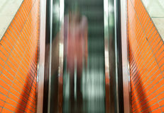 Top view on the blurred person on the escalator. Royalty Free Stock Photos
