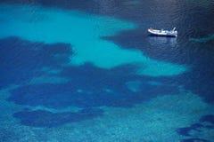 Top view of a boat in sea. Top view of a boat in turquoise sea Royalty Free Stock Image
