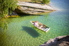 The top view the boat in transparent water with couple Royalty Free Stock Photo