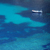 Top view of a boat in turquoise sea. Ibiza Royalty Free Stock Images
