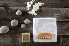 Top view, bodycare concept with soap, towel, pebbles and flowers Royalty Free Stock Photo
