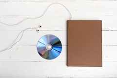 top view of book dcd disc and earphone Stock Photo