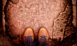 Top view boots on stoned pathway with copyspace Royalty Free Stock Photos