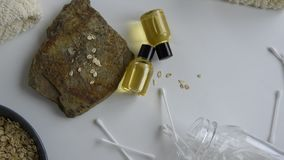 Top view of bottles with oats essential oil. Health care cosmetic products stock video
