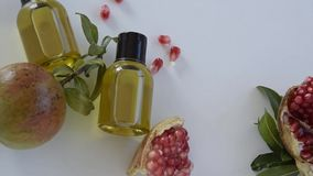 Top view of bottles with pomegranate seed essential oil