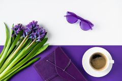 Top view of bouquet of purple hyacinth flowers and cup of coffee. On table Stock Photo