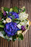 Top view of a bouquet of white and blue spring flowers Royalty Free Stock Image
