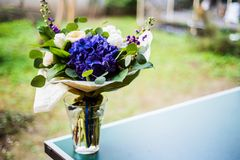 Top view of a bouquet of white and blue spring flowers Stock Image