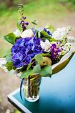 Top view of a bouquet of white and blue spring flowers Stock Photos
