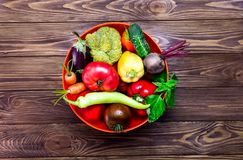 Top view bowl with different Fresh Farm Vegetables on the dark wooden background. Harvest. Food or Healthy diet concept.Vegetarian. Copy space for Text Stock Photography