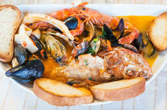 Top view of bowl with fish soup with seafood stock images