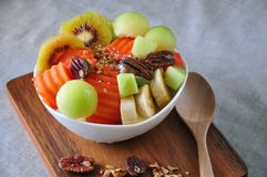 Top view Bowl of Healthy Fruits on Yogurt. Put on wooden board royalty free stock photography