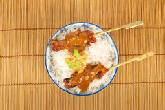 Top view of a bowl of rice with pork satay Royalty Free Stock Images