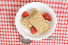 Top view bowl shredded wheat with strawberries Royalty Free Stock Image