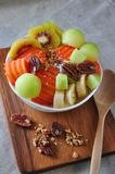Top view Bowl of Variety Fruits with Pecan. Top view of variety fruits with pecan on yogurt bowl stock photo