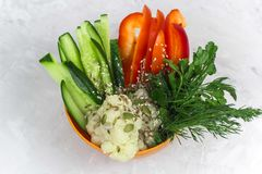 Top view bowl with vegetable slices. Cucumber, pepper, cauliflower, sesame, dill, pumpkin seed Royalty Free Stock Images