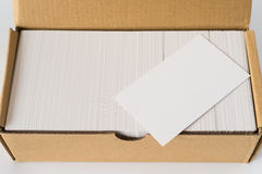 Top view box of business cards with a blank one good for text and logo stands on top Stock Images