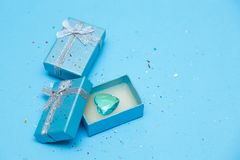 Top view of the box tied with silk ribbon on tiffany blue color pastel background stock photo