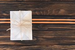 Top view of box wrapped by string and st george ribbon on wooden planks stock image
