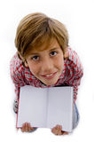Top view of boy showing book Royalty Free Stock Images