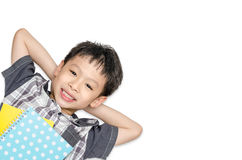 Top view of  boy smiles and lying on background Royalty Free Stock Photos