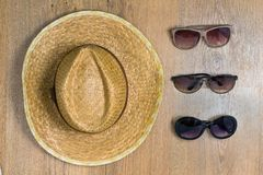 Top view of braided hat and three pair of glasses Royalty Free Stock Photography