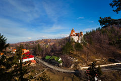 Top view of Bran Castle near village and road Royalty Free Stock Photos