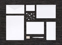 Top view of branding identity mockup and template on black table Royalty Free Stock Images