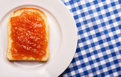 Top view on bread with apricot jam Royalty Free Stock Photo