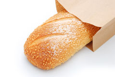 Top view bread in paper bag. On white Stock Images