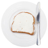 Top view of bread and spread with knife on plate Royalty Free Stock Images
