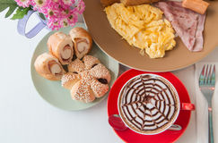 Top view breakfast and red cup of coffee. On white table Stock Photography
