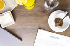 Top view of breakfast table.Concept of business breakfast.Empty space for your design. Vertical shot. Morning starts with coffee and fresh newspaper.Concept of royalty free stock photo