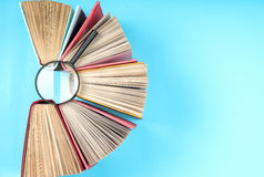 Top view of bright colorful hardback books in a circle. Stock Photos