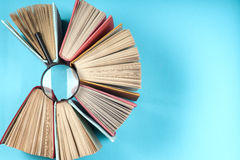 Top view of bright colorful hardback books in a circle. Royalty Free Stock Images