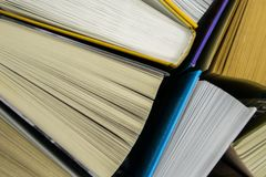 Top view of bright colorful hardback books in a circle. Open book, fanned pages stock photography