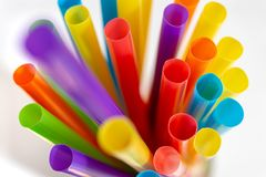 Plastic drinking straws and tubes royalty free stock images