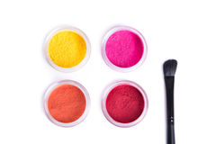 Top view of bright eye shadows and makeup brush Stock Photos