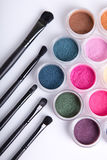 Top view of bright eye shadows and makeup brushes Royalty Free Stock Photo