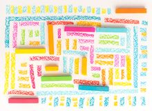 Top view of a bright geometric pattern made of colorful kid`s pa Fotos de archivo