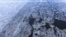 A top view from the broken ice to the undisturbed frozen river. stock video