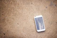 Top view of broken mobile phone drop on cement floor royalty free stock image