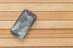 Top view broken of smart phone on wooden table Royalty Free Stock Photos