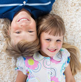 Top view of brother and sister lying on the floor Royalty Free Stock Photo