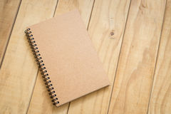 Top view of brown book on wooden table Stock Images