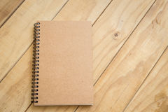 Top view of brown book on wooden table Royalty Free Stock Photos